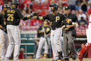 Andrew McCutchen #22 of the Pittsburgh Pirates celebrates with Gregory Polanco #25 after hitting a three run home run in the third inning during the game against the Cincinnati Reds at Great American Ball Park on September 8, 2015 in Cincinnati, Ohio.