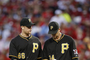 Justin Morneau #66 and A.J. Burnett #34 of the Pittsburgh Pirates talk on the mound during the game against the Cincinnati Reds at Great American Ball Park on September 27, 2013 in Cincinnati, Ohio. The Pirates won 4-1.