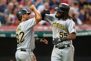 Elias Diaz #32 celebrates with Josh Bell #55 of the Pittsburgh Pirates after both scored on a home run by Bell during the fifth inning against the Cleveland Indians at Progressive Field on July 24, 2018 in Cleveland, Ohio.