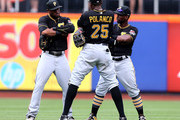 Starling Marte #6,Gregory Polanco #25 and Andrew McCutchen #22 of the Pittsburgh Pirates celebrate the win over the New York Mets on August 16, 2015 at Citi Field in the Flushing neighborhood of the Queens borough of New York City.The Pittsburgh Pirates defeated the New York Mets 8-1.