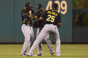 Starling Marte #6, Andrew McCutchen #22 and Gregory Polanco #25 of the Pittsburgh Pirates celebrate at the end of the game against the Philadelphia Phillies at Citizens Bank Park on May 11, 2015 in Philadelphia, Pennsylvania. The Pirates won 4-3.