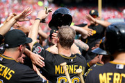 Justin Morneau #66 of the Pittsburgh Pirates is greeted in the dugout after scoring in the fifth inning against the St. Louis Cardinals during Game Two of the National League Division Series at Busch Stadium on October 4, 2013 in St Louis, Missouri.
