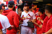 Matt Holliday #7 of the St. Louis Cardinals is congratulated by his teammates after taking the field for the last time as a member of the St. Louis Cardinals during the ninth inning of a game against the Pittsburgh Pirates at Busch Stadium on October 2, 2016 in St. Louis, Missouri.