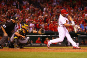 Matt Holliday #7 of the St. Louis Cardinals hits a solo home run against the Pittsburgh Pirates in the seventh inning at Busch Stadium on September 30, 2016 in St. Louis, Missouri.