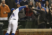 Anthony Rizzo #44 of the Chicago Cubs and a fan attempt to catch a foul ball hit by Francisco Cervelli #29 of the Pittsburgh Pirates during the ninth inning on September 26, 2018 at Wrigley Field in Chicago, Illinois.