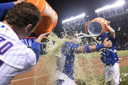 Anthony Rizzo (L) of the Chicago Cubs and Kyle Schwarber (R) pour gatorade on Albert Almora Jr. (C) of the Chicago Cubs after his game-winning walk-off single against the Pittsburgh Pirates during the tenth inning on September 26, 2018 at Wrigley Field in Chicago, Illinois. The Cubs won 7-6.