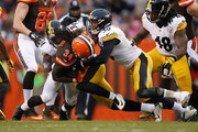 Isaiah Crowell #34 of the Cleveland Browns gets tackled by Lawrence Timmons #94 and Ryan Shazier #50 of the Pittsburgh Steelers during the second quarter at FirstEnergy Stadium on January 3, 2016 in Cleveland, Ohio.