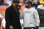 Cleveland Browns General Manager Ray Farmer talks with head coach Mike Tomlin of the Pittsburgh Steelers at FirstEnergy Stadium on January 3, 2016 in Cleveland, Ohio.