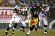 Trent Edwards #11 of the Philadelphia Eagles runs for a first down in front of  Brandon Hicks #44 of the Pittsburgh Steelers during a preseason game at Lincoln Financial Field on August 9, 2012 in Philadelphia, Pennsylvania.