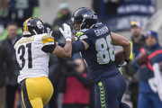 Tight end Jimmy Graham #88 of the Seattle Seahawks runs with the ball after a reception as defensive back Ross Cockrell #31 of the Pittsburgh Steelers tries to make a tackle during the first half of a football game at CenturyLink Field on November 29, 2015 in Seattle, Washington. The Seahawks won the game 39-30.