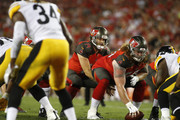 Quarterback Ryan Fitzpatrick #14 of the Tampa Bay Buccaneers controls the offense during the first quarter of a game against the Pittsburgh Steelers on September 24, 2018 at Raymond James Stadium in Tampa, Florida.