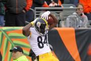 Antonio Brown #84 of the Pittsburgh Steelers celebrates after scoring the game-winning touchdown during the fourth quarter of the game against the Cincinnati Bengals at Paul Brown Stadium on October 14, 2018 in Cincinnati, Ohio. Pittsburgh defeated Cincinnati 28-21.