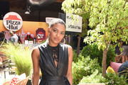 China Anne McClain of 'Black Lightning' attends the Pizza Hut Lounge at 2019 Comic-Con International: San Diego on July 20, 2019 in San Diego, California.