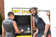 (L-R) China Anne McClain and Cress Williams of 'Black Lightning' attend the Pizza Hut Lounge at 2019 Comic-Con International: San Diego on July 20, 2019 in San Diego, California.
