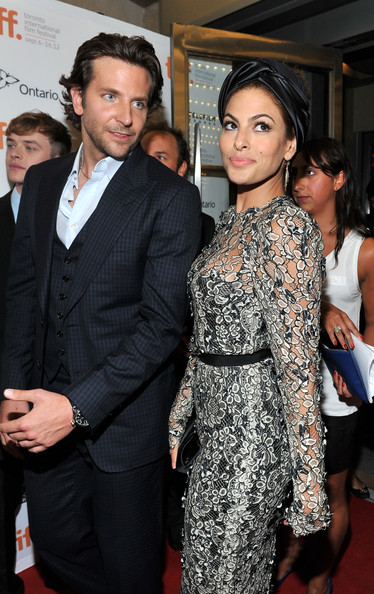 She goes to premieres with Bradley Cooper.