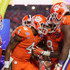Deshaun Watson #4 of the Clemson Tigers reacts after scoring a third quarter touchdown with teammates Wayne Gallman #9, and Mike Williams #7 during the 2016 PlayStation Fiesta Bowl against the Ohio State Buckeyes at University of Phoenix Stadium on December 31, 2016 in Glendale, Arizona.