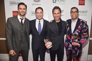 (L-R) Cheyenne Jackson, Jorge Valencia, Executive Director & CEO of Point Foundation, Point Impact Award Honoree Eric McCormack, and Point Horizon Award Honoree Steven Canals pose backstage at Point Foundation?s Point Honors gala at The Beverly Hilton Hotel on October 13, 2018 in Beverly Hills, California.
