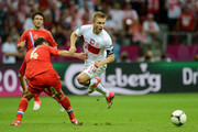 Jakub Blaszczykowski of Poland evades Sergey Ignashevich of Russia during the UEFA EURO 2012 group A match between Poland and Russia at The National Stadium on June 12, 2012 in Warsaw, Poland.