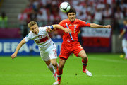 Jakub Blaszczykowski of Poland and Yuriy Zhirkov of Russia compete for the ball during the UEFA EURO 2012 group A match between Poland and Russia at The National Stadium on June 12, 2012 in Warsaw, Poland.