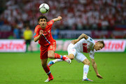 Yuriy Zhirkov of Russia and  Eugen Polanski of Poland compete for the ball during the UEFA EURO 2012 group A match between Poland and Russia at The National Stadium on June 12, 2012 in Warsaw, Poland.