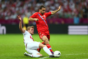 Jakub Blaszczykowski of Poland tackles Aleksandr Kerzhakov of Russia during the UEFA EURO 2012 group A match between Poland and Russia at The National Stadium on June 12, 2012 in Warsaw, Poland.