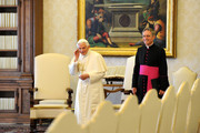 Pope Benedict XVI (L), flanked by his personal secretary Monsignor Georg Ganswein (R), waits at his private library for a meeting with the President of the Republic of Macedonia Nikola Gruevski on May 24, 2012 in Vatican City, Vatican.