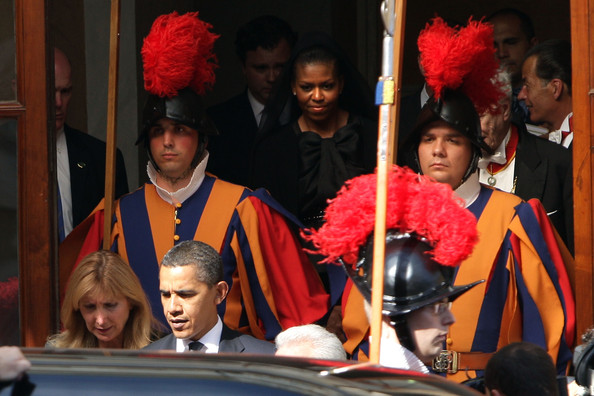 US President Barack Obama and First Lady Michelle Obama leave the Vatican at the end of their meeting with Pope Benedict XVI on July 10, 2009 in Vatican City, Vatican. Obama was meeting with The Pope for the first time as President following the G8 summit in L'Aquila, Italy.