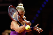Sabine Lisicki of Germany plays a forehand in her match against Timea Babos of Hungary during Day 1 of the Porsche Tennis Grand Prix at Porsche-Arena on April 18, 2016 in Stuttgart, Germany.