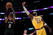 Damian Lillard #0 of the Portland Trail Blazers grabs a rebound in front of LeBron James #23 of the Los Angeles Lakers during the second half at Staples Center on January 31, 2020 in Los Angeles, California.