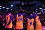 (L-R) Anthony Davis, LeBron James, Quinn Cook and Kentavious Caldwell-Pope of the Los Angeles Lakers reacts at the end of the National Anthem during a ceremony to honor Kobe Bryant before the game against the Portland Trail Blazers at Staples Center on January 31, 2020 in Los Angeles, California.