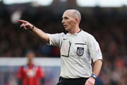 Referee Mike Dean points during the Emirates FA Cup Fourth Round match between Portsmouth and AFC Bournemouth at Fratton Park on January 30, 2016 in Portsmouth, England.