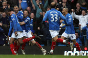 Kanu of Portsmouth celebrates scoring the winning goal during the Barclays Premier League match between  Portsmouth and Hull City at Fratton Park on March 20, 2010 in Portsmouth, England.