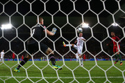 Hannes Halldorsson of Iceland saves the header by Cristiano Ronaldo of Portugal  during the UEFA EURO 2016 Group F match between Portugal and Iceland at Stade Geoffroy-Guichard on June 14, 2016 in Saint-Etienne, France.
