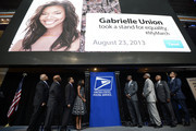 Thurgood Marshall, Jr, John Lewis, Alexander Williams, Gabrielle Union, Ronald Stroman, Wade Henderson, Joe Coleman and Scott Williams attend the U.S. Postal Service Unveiling of the 1963 March On Washington Stamp on August 23, 2013 in Washington, United States.