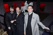 Francesco Vezzoli (L), Luca Guadagnino (C) and Oliver Sim (R) attend the Prada Show during Milan Menswear Fashion Week Fall/Winter 2020/21 on January 12, 2020 in Milan, Italy.