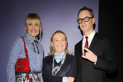 Liv Corfixen (L), Miuccia Prada (C) and Nicolas Winding Refn (R) attend the Prada Show during Milan Menswear Fashion Week Fall/Winter 2020/21 on January 12, 2020 in Milan, Italy.