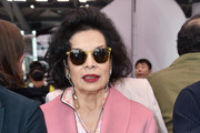 Bianca Jagger (in Prada) while attending the Prada Resort 2018 Womenswear Show in Osservatorio on May 7, 2017 in Milan, Italy.