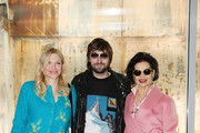 Courtney Love, Francesco Vezzoli and Bianca Jagger (all in Prada) while attending the Prada Resort 2018 Womenswear Show in Osservatorio on May 7, 2017 in Milan, Italy.