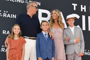 """(L-R) Grace Avery Costner, Kevin Costner, Hayes Logan Costner, Christine Baumgartner, and Cayden Wyatt Costner attend the premiere of 20th Century Fox's """"The Art of Racing in the Rain"""" at El Capitan Theatre on August 01, 2019 in Los Angeles, California."""