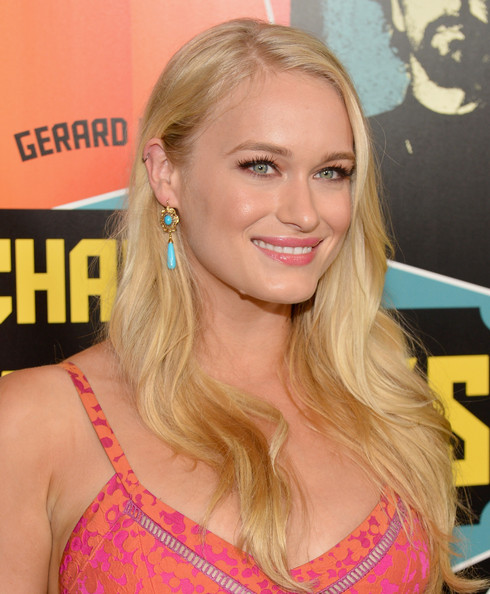 Leven Rambin kept her look colorful with these turquoise drop earrings.