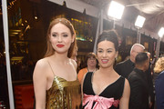 """(L-R) Karen Gillan and Cara Gee attend the Premiere of 20th Century Studios' """"The Call of the Wild"""" at El Capitan Theatre on February 13, 2020 in Los Angeles, California."""