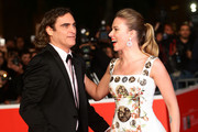 She laughs with Joaquin Phoenix on the red carpet. - Scarlett Johansson's Celebrity Friends