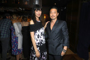 Actors Kentez Asaka (R) and Tao Okamoto attend the premiere of Breaking Glass Pictures' 'She's Just A Shadow' after party at The Spare Room on July 18, 2019 in Hollywood, California.