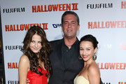 """Actors Danielle Harris (R) and Scout Taylor-Compton pose with Malek Akkad at the Premiere Of Dimension Films' """"Halloween II"""" at Grauman's Chinese Theatre on August 24, 2009 in Hollywood, California."""