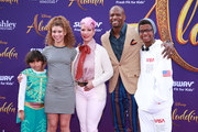 """Rebecca King-Crews and Terry Crews (C) and family attend the premiere of Disney's """"Aladdin"""" on May 21, 2019 in Los Angeles, California."""