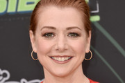 """Alyson Hannigan attends the premiere of Disney Channel's """"Kim Possible"""" at The Television Academy on February 12, 2019 in Los Angeles, California."""