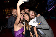 "(L-R) Actors Scott Adsit, Ryan Potter, Daniel Henney, Genesis Rodriguez, Jamie Chung and T.J. Miller take a selfie during the premiere of Disney's ""Big Hero 6"" at the El Capitan Theatre on November 4, 2014 in Hollywood, California."