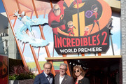 "Brad Bird, John Walker and Nicole Paradis Grindle attend the premiere of Disney and Pixar's ""Incredibles 2"" at the El Capitan Theatre on June 5, 2018 in Los Angeles, California."