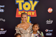 """Christina Milian (L) and family attend the premiere of Disney and Pixar's """"Toy Story 4"""" on June 11, 2019 in Los Angeles, California."""