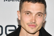 """Karl Glusman attends the premiere of FX's """"Devs""""at ArcLight Cinemas on March 02, 2020 in Hollywood, California."""